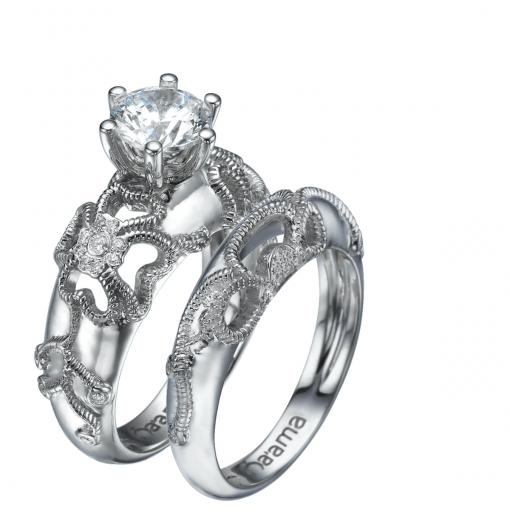 white gold floral engagement ring and matching wedding ring